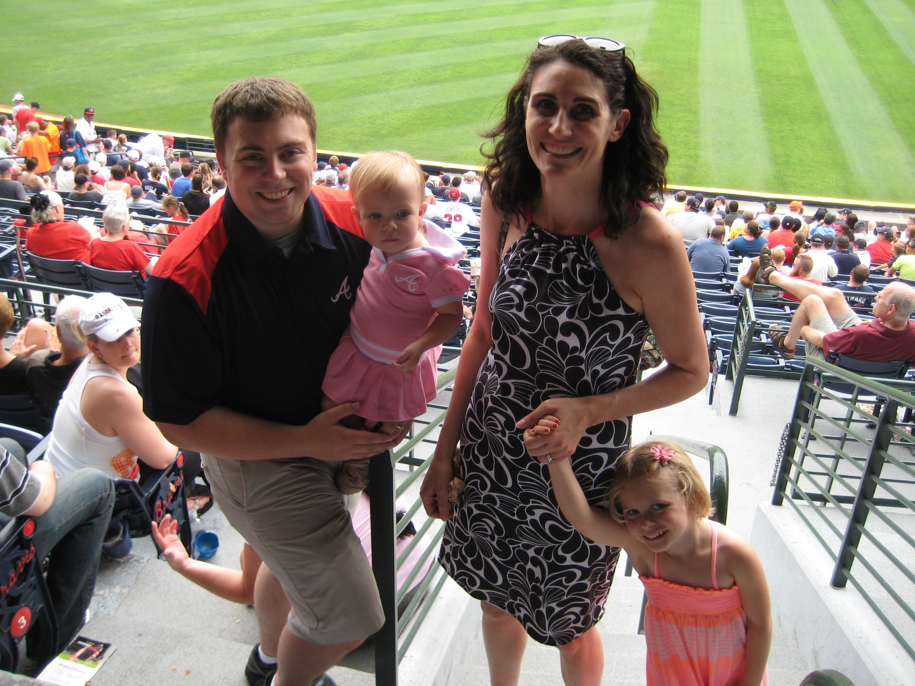 David N. and Elizabeth H. enjoy the 7th inning stretch with their girls during the 2013 Braves game.