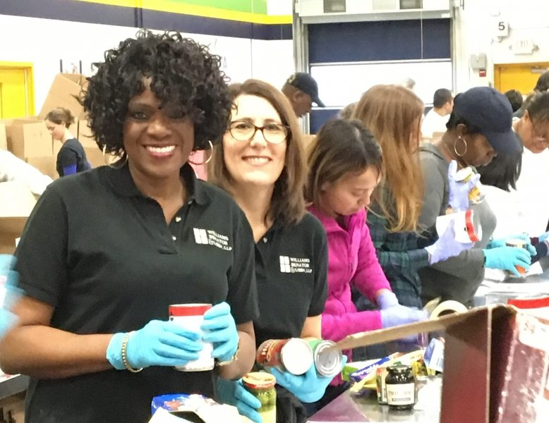 Ann and Jamie sort food donations during WBL's 2017 community service day at the Atlanta Community Food Bank.