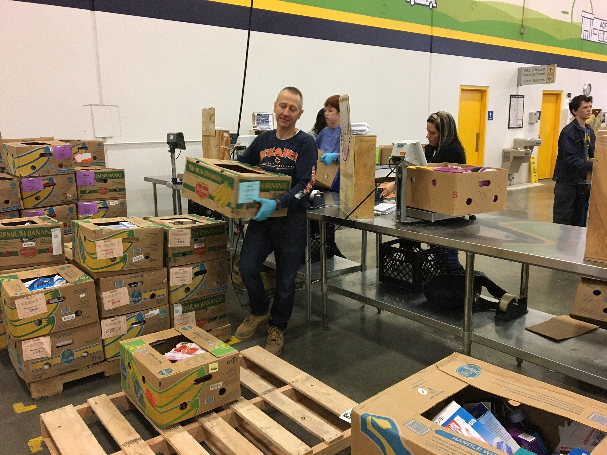 Tax partner Kevin Hedrick stacking packed food boxes (ACFB 2016).