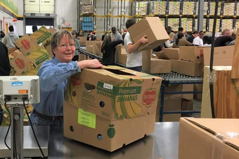 Laura puts the finishing touches on an outbound food box (ACFB 12/6/2017).