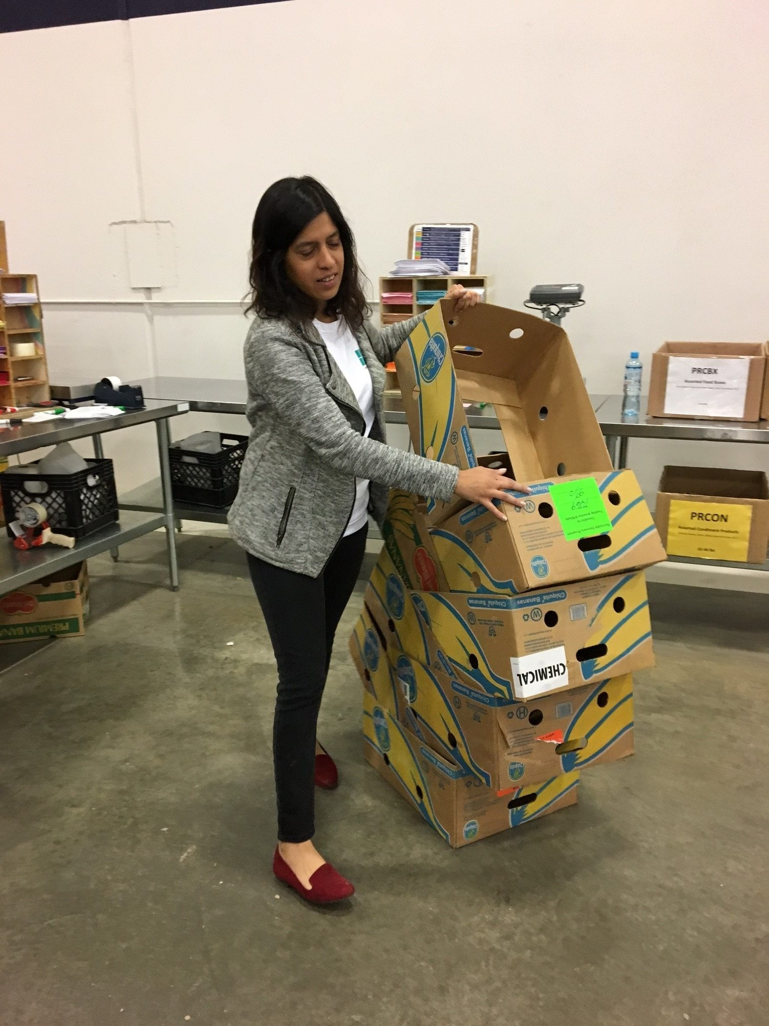 Sabika preps another box to pack (ACFB 2016).