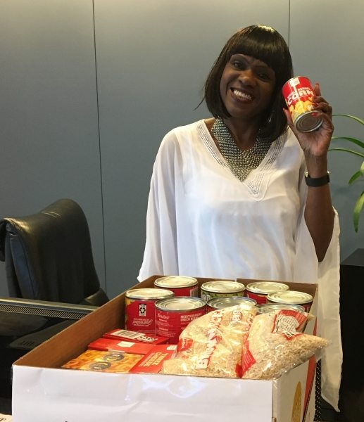 Ann fills her team's donation box during the 2017 Food Fight benefiting the Atlanta Community Food Bank.