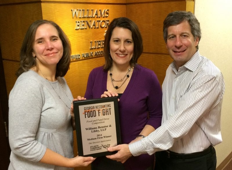 Jamie and Bruce receive WBL's plaque for winning the GSCPA and Atlanta Community Food Bank's first annual Food Fight in 2014.