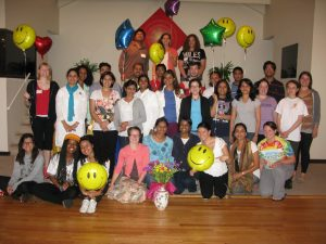 Jaymini (standing in front row, fourth from left) at a youth retreat held at Peace Village in New York.